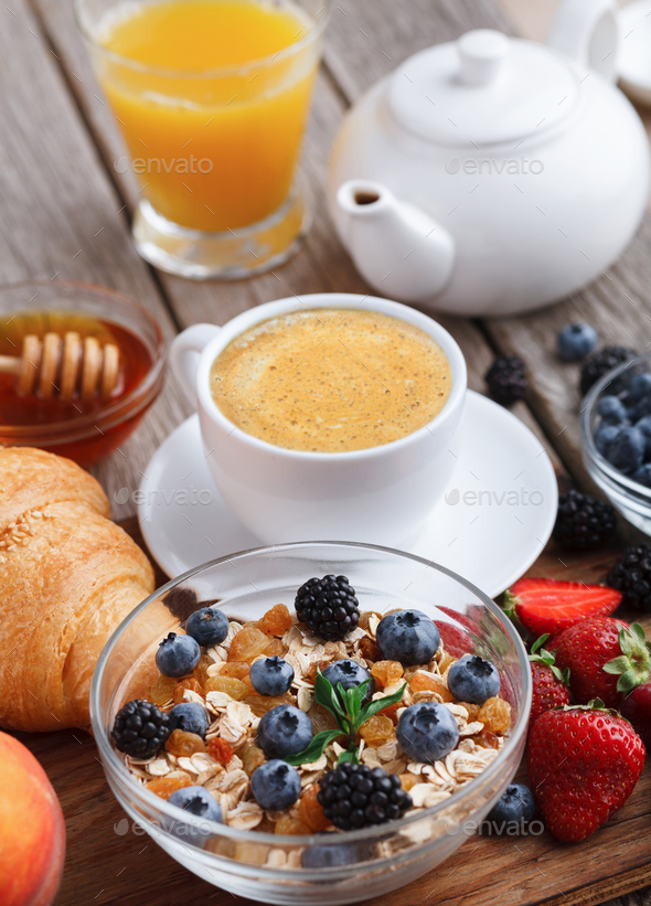 Fresh crusty croissants and muesli for morning meals - Stock Photo - Images