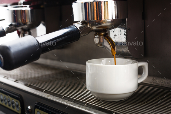 Professional coffee machine making espresso in a cafe - Stock Photo - Images