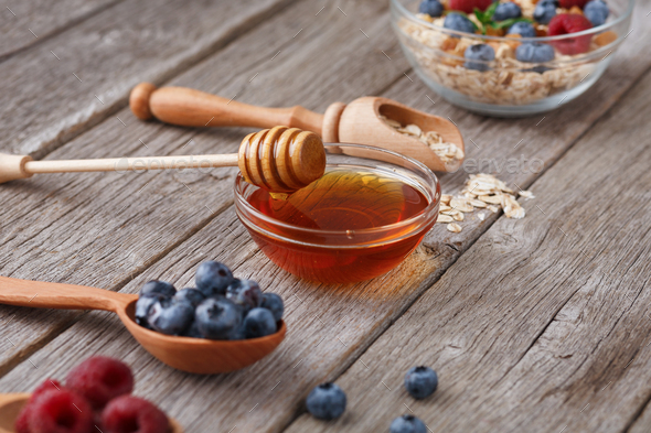 Healthy morning meals background. Tasty ingredients in wooden spoons - Stock Photo - Images