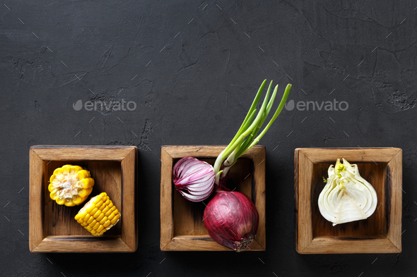 Diverse cooking ingredients in wooden boxes, copy space - Stock Photo - Images