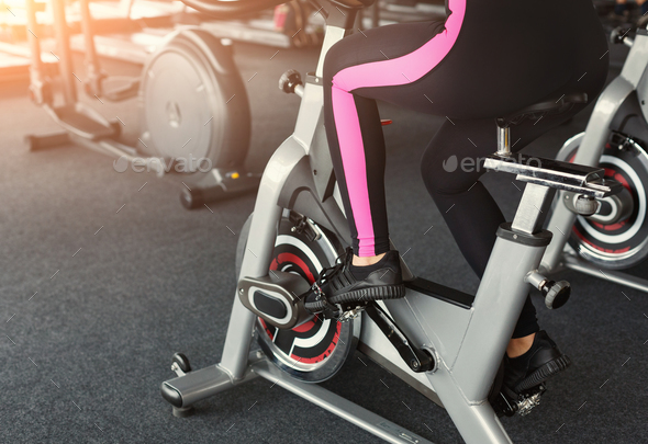 Woman's legs on exercise bikes in fitness club, healthy lifestyle - Stock Photo - Images