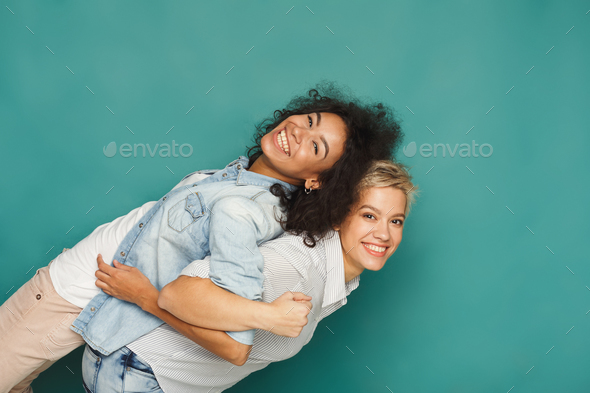 Emotional friends having fun at blue background - Stock Photo - Images