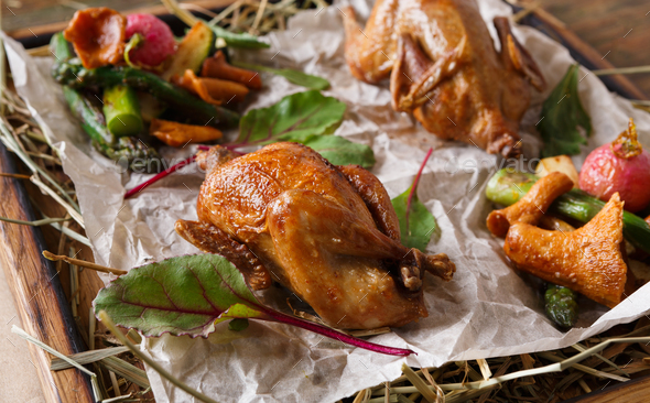 Modern restaurant food. Quails baked with asparagus and chantere - Stock Photo - Images