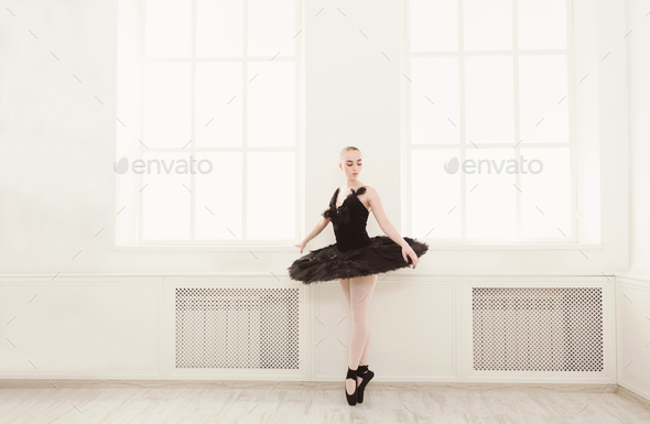 Beautiful graceful ballerina in black swan dress - Stock Photo - Images