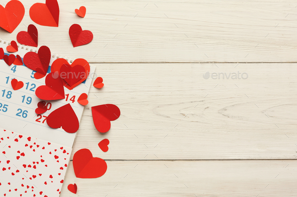 Calendar page with the red hearts on february 14 - Stock Photo - Images