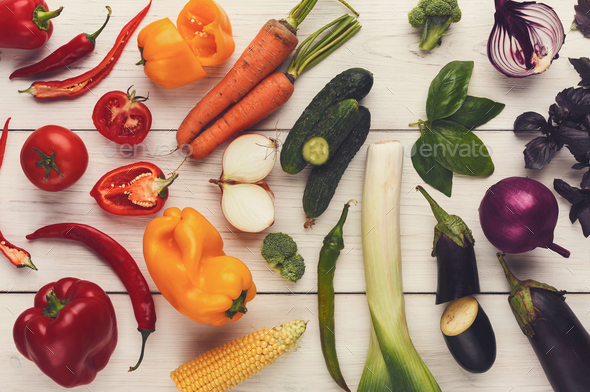 Rainbow background with lots of colorful vegetables - Stock Photo - Images