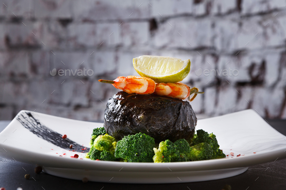 Modern restaurant food. Dorado fillet in nori with shrimps - Stock Photo - Images