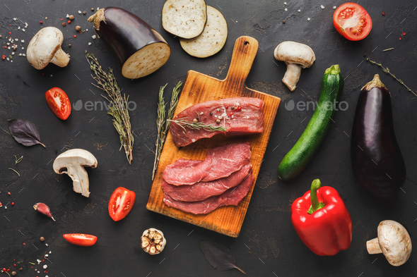 Raw beef filet mignon steaks on wooden board - Stock Photo - Images