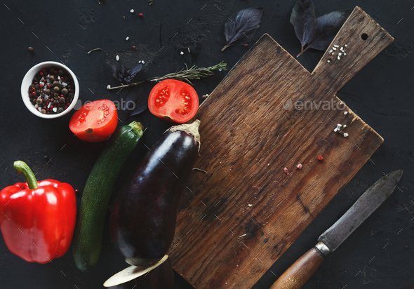 Wooden desk with vegetables on dark background - Stock Photo - Images