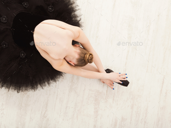Graceful Ballerina stretching, ballet background, top view - Stock Photo - Images