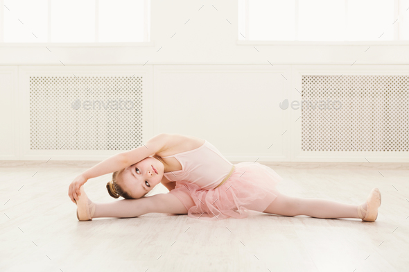 Portrait of little ballerina on floor, copy space - Stock Photo - Images