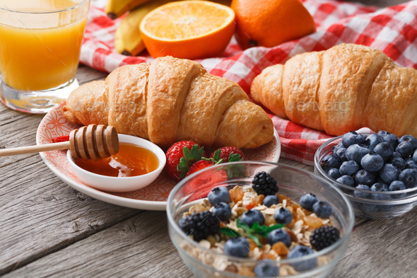 Fresh crusty croissants and orange juice for morning meals - Stock Photo - Images