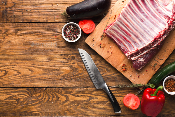 Raw rack of lamb on wooden board - Stock Photo - Images