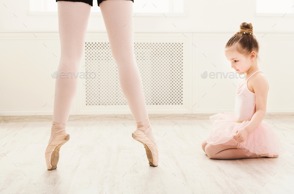 Little girl looking at professional ballet dancer - Stock Photo - Images