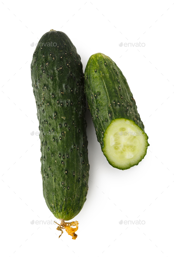Green cucumber whole cut in half, isolated - Stock Photo - Images