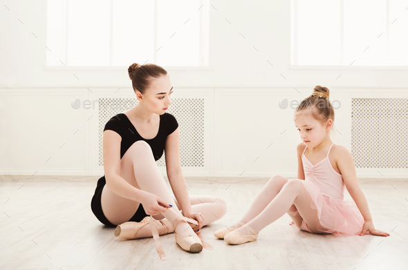 Little girl learn ballet with teacher copy space - Stock Photo - Images