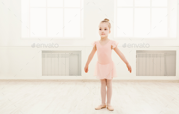 Little cute ballerina exercising in ballet costume - Stock Photo - Images