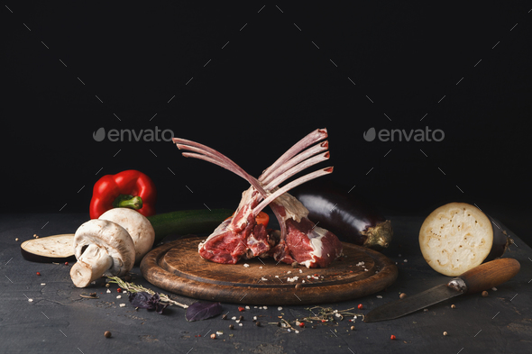 Raw cut rack of lamb on wooden board - Stock Photo - Images