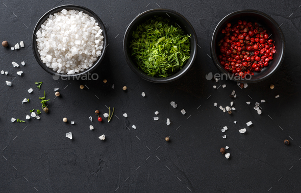 Diverse spices in plates on dark background, closeup, copy space - Stock Photo - Images