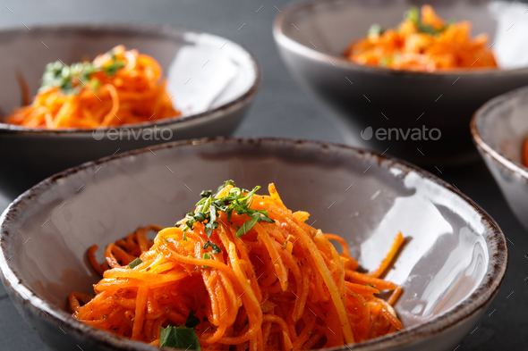 Set of plates with russian korean salad, closeup - Stock Photo - Images