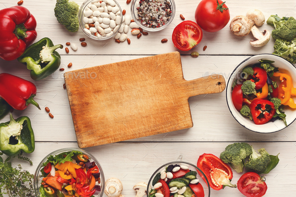Various salad bowls on white wooden table, top view - Stock Photo - Images