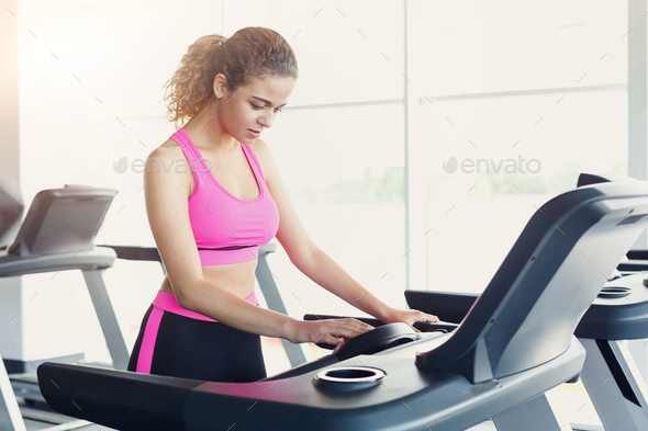 Attractive woman on treadmill in fitness club, healthy lifestyle - Stock Photo - Images