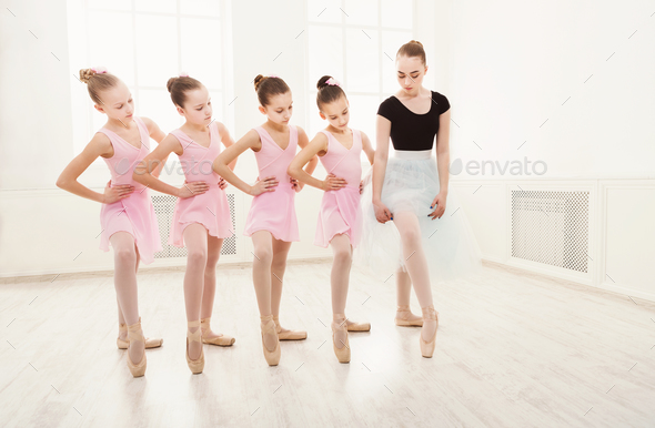 Teacher helping her students during dance class - Stock Photo - Images