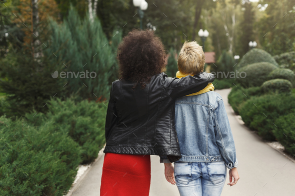 Happy girls having fun while walking in the park - Stock Photo - Images