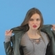 Hot Girl in Leather Jacket Poses By the Camera Seductive Look, Stylish Wear Blue Background - VideoHive Item for Sale