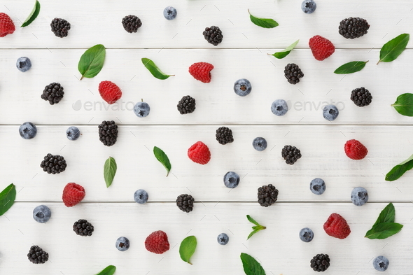 Assorted berries on white wooden table top view - Stock Photo - Images