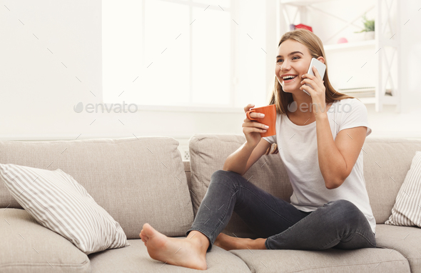 Smiling young girl calling on mobile phone - Stock Photo - Images