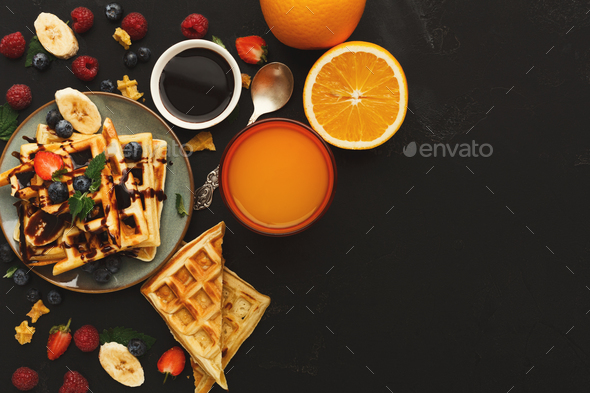 Belgian waffles with berries and fruits copy space - Stock Photo - Images