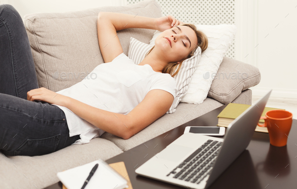 Casual blonde girl sleeping on the sofa - Stock Photo - Images