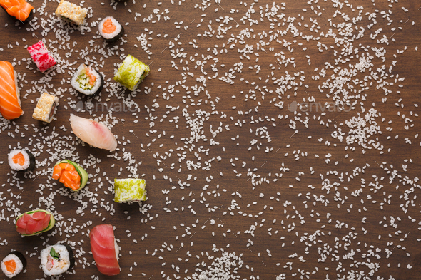 Set of sushi, maki and rolls with sesame on wooden rustic background, copy space - Stock Photo - Images