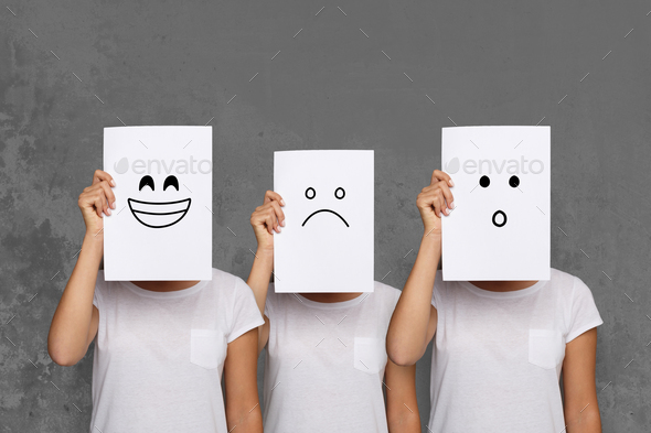 Girl covering face with white boards. Set of painted emotions - Stock Photo - Images