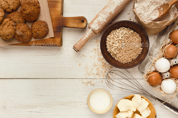 Oatmeal cookies and baking ingredients for homemade pastry background - Stock Photo - Images