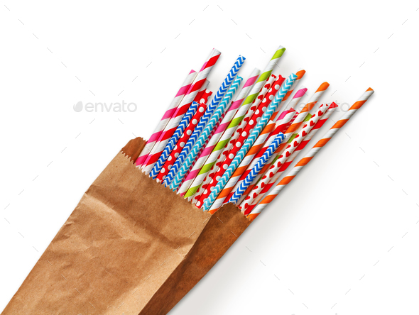 Colorful party cocktail straws in craft paper bag - Stock Photo - Images