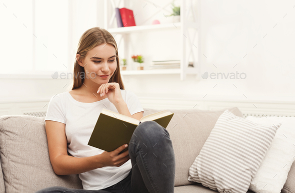 Young woman reading her notes - Stock Photo - Images