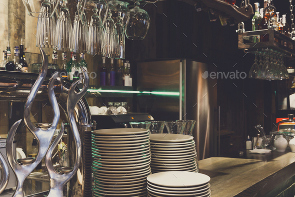 Bar counter with clean dishes close up - Stock Photo - Images