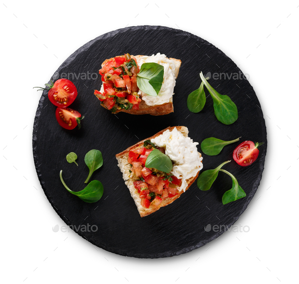 Bruschetta with cheese and vegetables isolated - Stock Photo - Images