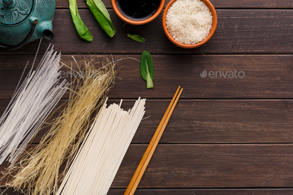 Different kinds of pasta on wooden table - Stock Photo - Images