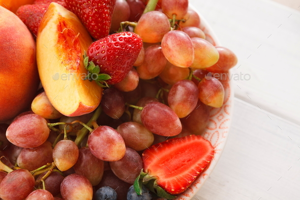 Mixed fruits and berries in glass bowls closeup, top view - Stock Photo - Images