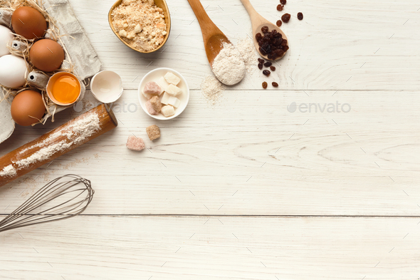 Baking background with eggs and flour on white rustic wood - Stock Photo - Images