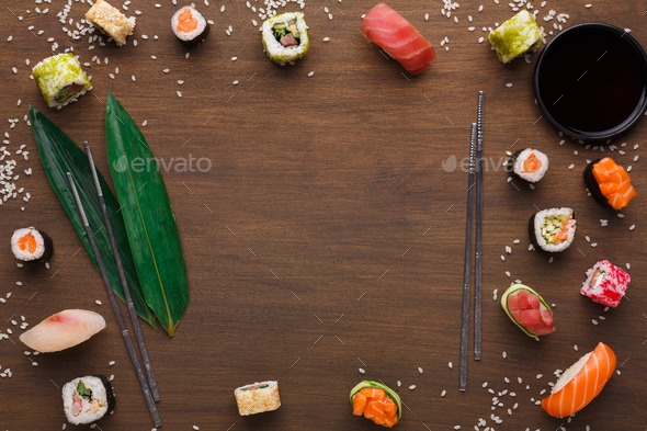 Sushi and rolls background, frame on black, top view. - Stock Photo - Images