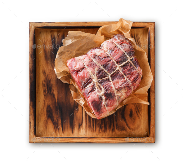 Raw aged prime black angus beef in craft paper - Stock Photo - Images