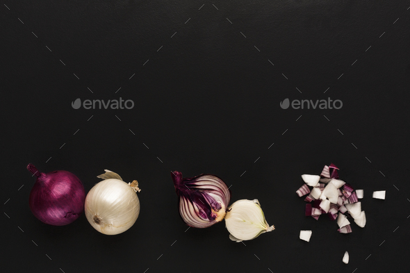 Whole and cut violet onion on black isolated background - Stock Photo - Images