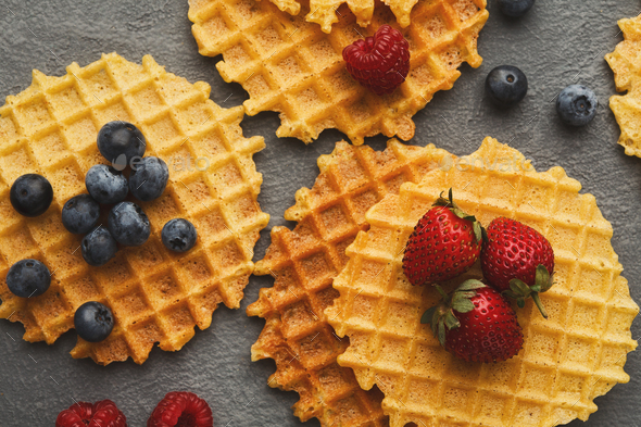 Round belgium waffles with berries - Stock Photo - Images