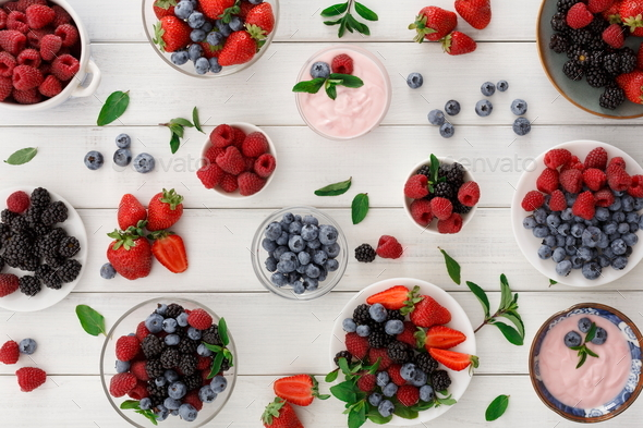 Healthy breakfast with berries and yogurt on white wooden table - Stock Photo - Images