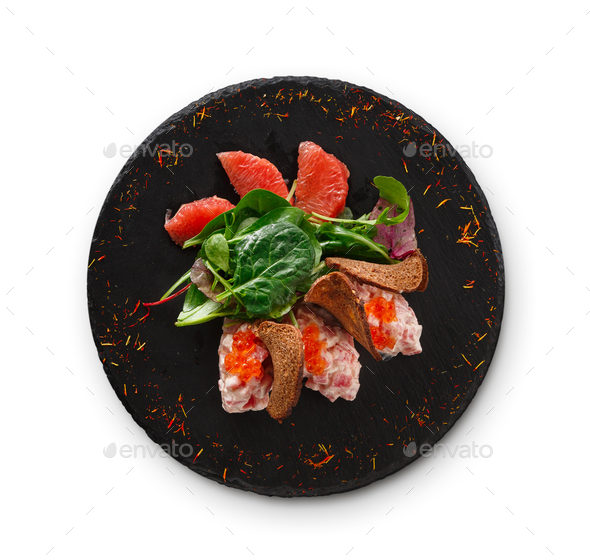 Gourmet seafood snack on black plate isolated - Stock Photo - Images