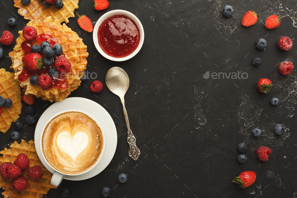 Round belgium waffles with berries, tasty breakfast on black background - Stock Photo - Images